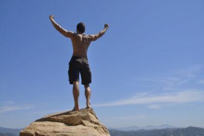 Celebrates achievement of climbing to top of peak